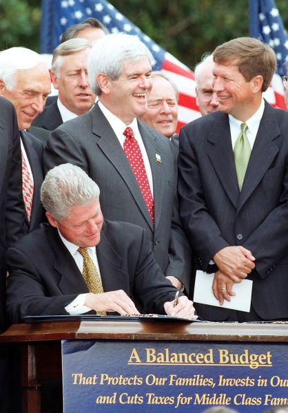 WASHINGTON, :  US House Majority Leader Newt Gingrich (2nd-R), R-GA, talks with John Kasich (R), R-OH, while US President Bill Clinton signs the Balanced Budget Agreement on the South Lawn of the White House 05 August in Washington.   The budget agreement, which will balance the federal budget by the year 2002, includes the largest tax cuts in 16 years as well as an increase in tobacco tax.  AFP PHOTO  Paul J. RICHARDS (Photo credit should read PAUL J. RICHARDS/AFP/Getty Images)