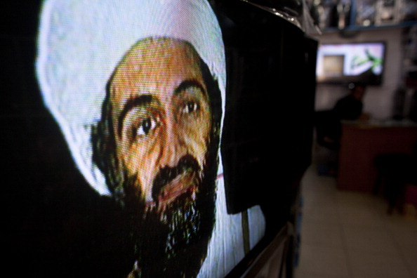Afghans watch television coverage announcing the killing of Al-Qaeda leader Osama bin Laden  (Photo by Majid Saeedi/Getty Images).