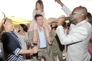 (L-R) Hugh Jackman's wife, Hugh Jackman, and Wyclef Jean, rapping on Governors Island (PMc)