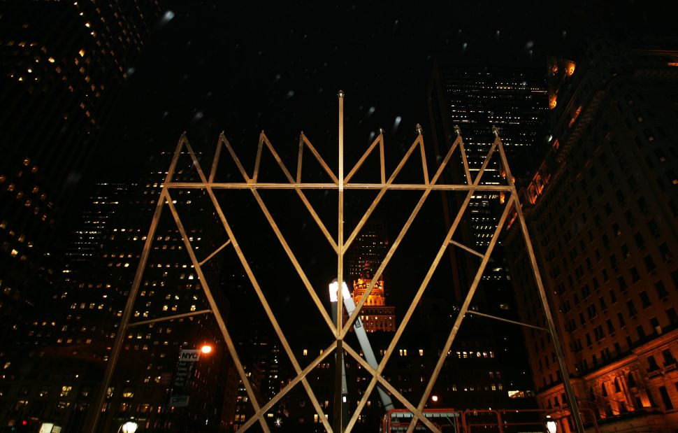 """A structure billed as the """"World's Largest Menorah"""" by Jewish leaders stands at the corner of Fifth Avenue and 59th Street."""