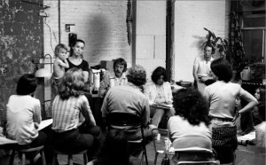 Etan Patz's mother, Julie (holding her youngest son), and his father, Stan (far right), organizing a search effort in the days after the child's disappearance. (Photo by Allen Arpadi)