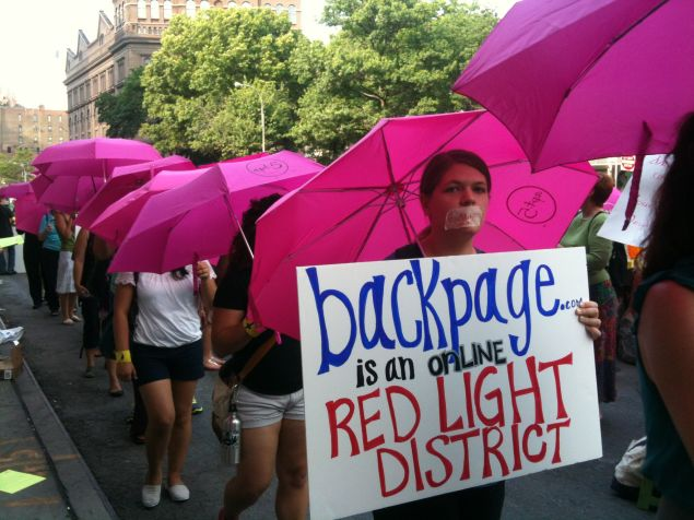 """Activists protest Backpage's """"escort services"""" site in 2012. A new court ruling says pimps used that section of the site to lure underage prostitutes. (Photo: Melissa Gira Grant/Observer)"""