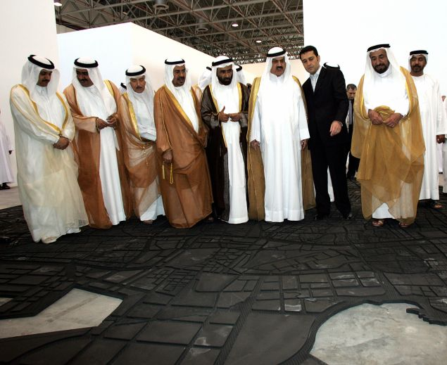 Sheikh Sultan Bin Mohammed Al Qasimi, the ruler of Sharjah, viewing a work by by Lebanese artist Marwan Rachmawi at the Sharjah Biennial 7 in 2005. (Courtesy Rabih Moghrabi/AFP/Getty Images)
