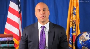 Cory Booker with his holy books at his side. (Photo: YouTube)
