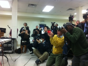 Photographers capture pictures of the subway victim's family.