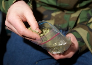 Seattle resident displaying a bag of marijuana shortly after a lew legalizing recreational use of the drug took effect in Washington State last month. (Photo: Getty)