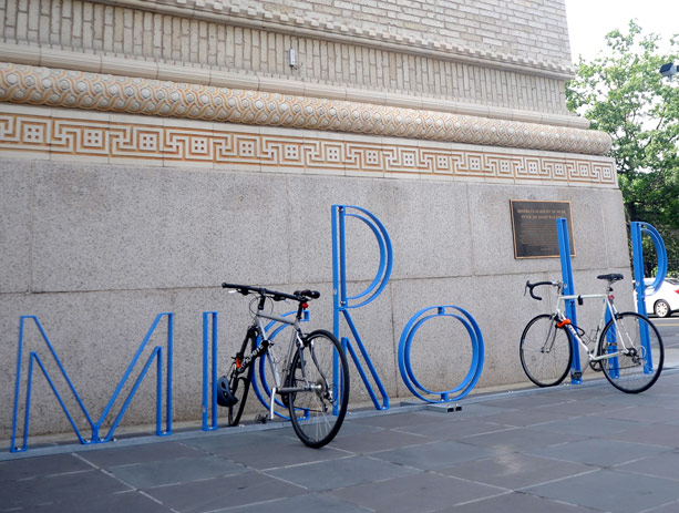 """Mr. Byrne's other bike rack—this one spelling """"MICRO LIP""""—outside the Brooklyn Academy of Music. (bam.org)"""