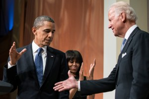 President Obama and Vice President Biden shake hands at his inaugural ceremony.