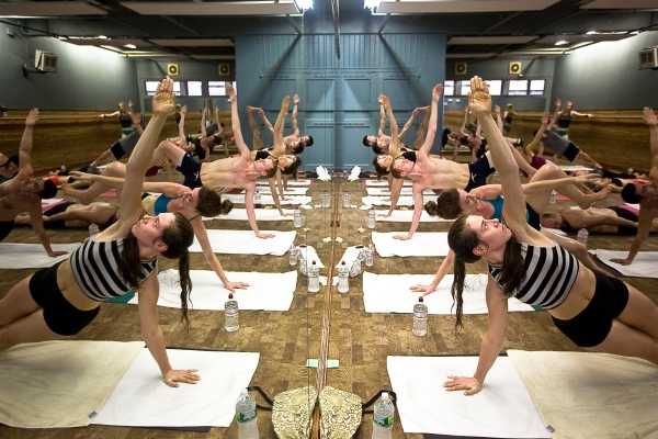Hot yoga practitioners perform Vasisthasana, or the Side Plank Pose, in a new Bikram-less class at Yoga to the People. (Photo by Emily Anne Epstein)