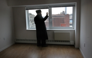 Rabbi David Niederman looks out of the window of the Schaefer Building.