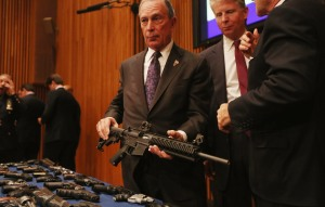 Mayor Michael Bloomberg holding an AR-15 assault rifle like the one used in the Newtown shootings at a press conference announcing a gun trafficking bust last October. (Photo: Getty)
