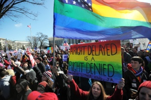 Same-sex marriage supporters shout slogans in front of the US Supreme Court. (Photo: Getty)