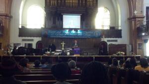 John Liu addressing the congregation.