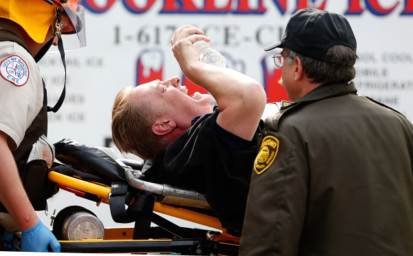 A man is loaded into an ambulance after he was injured by one of two bombs exploded during the 117th Boston Marathon near Copley Square on April 15, 2013 in Boston, Massachusetts. (Getty Images)