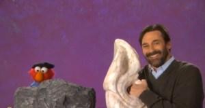 Elmo and Jon Hamm make art. (PBS)