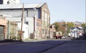 The site is currently made up of vacant lots and underused industrial structures.