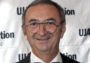 Mr. Sapir, owner of silver ice buckets.