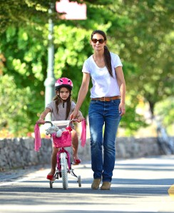 Katie and Suri strolling and riding.
