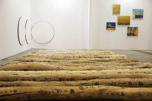 Boers-Li Gallery's booth, with 'Fondle' (2009–13) by Yang Xinguangon on the ground. (Jessica Hromas/Getty Images)