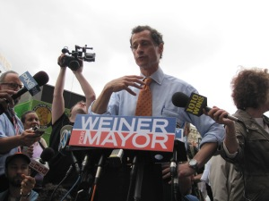 Anthony Weiner talking to reporters in Harlem Thursday morning.