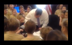 Governor Christie takes aim at a spider on his desk.