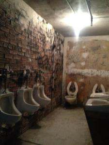 the Met's CBGB bathrooms. (Courtesy Twitter/Walter Robinson)