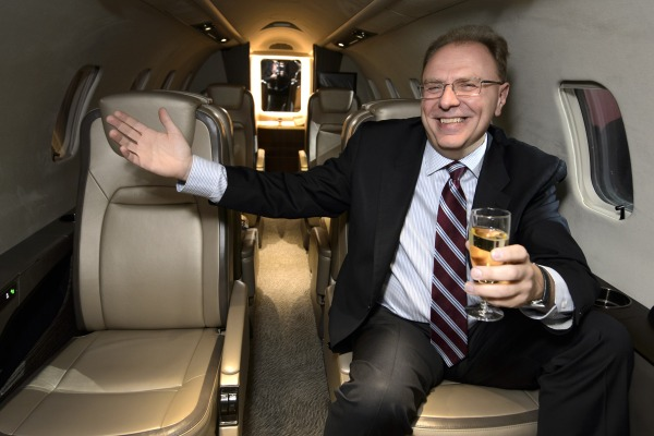 The president of the business jet unit of Canadian manufacturer Bombardier, Steven Ridolfi, poses inside a model of the new Learjet 75 that was unveiled at the European Business Aviation Convention and Exhibition (EBACE) in Geneva.
