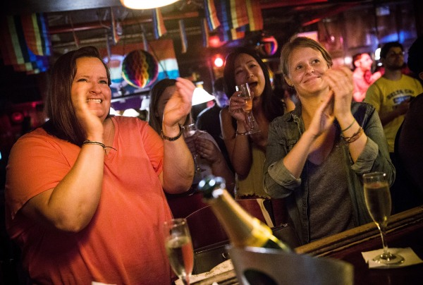 Rachel Howald, Kate Lummus, Virginia Sin and Gretchen Menter celebrate at the Stonewall Inn. (Getty)