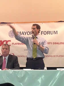 Anthony Weiner stands at a Flatbush Jewish Community Coalition forum on Tuesday.
