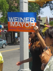A member of the Weiner campaign holds up a sign on Austin Street.
