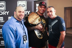Tyrone Spong (center) took home the championship belt and $200,000 prize