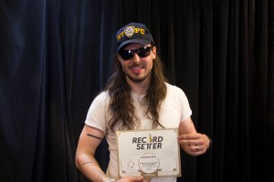 Andrew W.K. posing with his new world record. (Photo by Hugh Bassett)