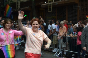 Christine Quinn exuberantly greeting the crowd on the parade route.