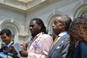 Council Member Jumaane Williams and Reverend Al Sharpton praise passage of racial profiling bill.