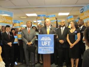 Michael Mulgrew announces the UFT's endorsement at its headquarters Wednesday.