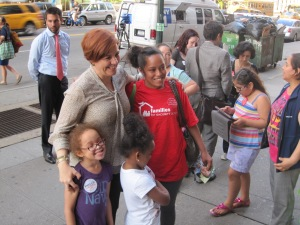 Christine Quinn posing with charter school kids outside the forum.