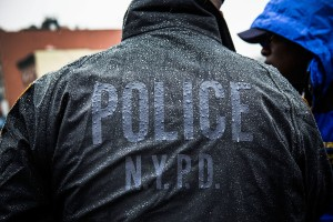 A police officer observes an anti-stop-and-frisk rally in February. (Photo: Getty)