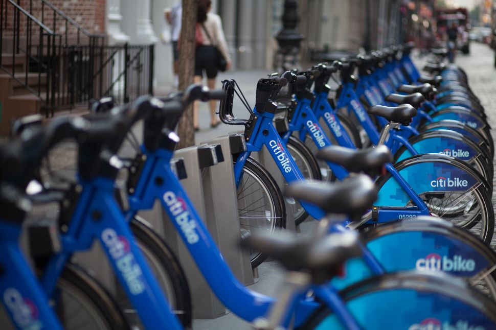 A West Village bike shop owner claims that lines of Citi Bikes like this one have forced his business to close (Photo: Amanda Cohen)