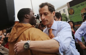 Anthony Weiner hugs a man in Harlem during his campaign kick-off. (Photo: Mario Tama/Getty Images)