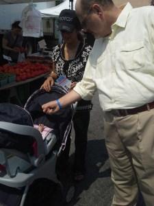 Republican Joe Lhota high fives a baby today.