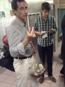 Anthony Weiner waits, with his cupcakes, for an elevator ride.
