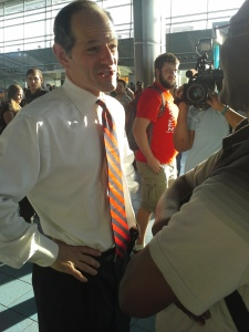 Eliot Spitzer schmoozes with a voter in the Staten Island ferry terminal.