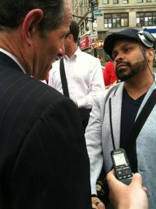 Eliot Spitzer talking to a potential voter in the Bronx.