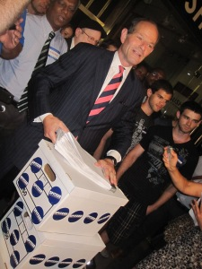 Eliot Spitzer arrives with his signatures.