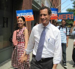 Huma Abedin and her husband, Anthony Weiner, on the campaign trail Sunday.