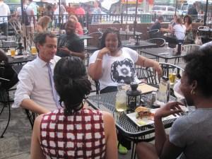 Mr. Weiner and Huma Abedin making friends at Harlem Tavern.