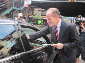 Eliot Spitzer stopping traffic this morning in Queens.
