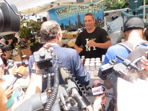 Spitzer purchased a jar of honey at the green market.