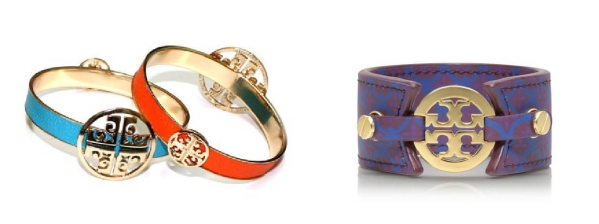 """(L): Lin & J bracelets bearing the """"Isis Cross"""" design, which Tory Burch has deemed a counterfeit version of her brand's own trademark. (R): The Tory Burch Skinny Double Snap bracelet, featuring the """"TT"""" logo."""