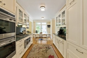 Unlike some of the more extravagant units, the Zeckendorfs' original, rather traditional kitchen design in the second-floor unit has not (yet) been ripped out.